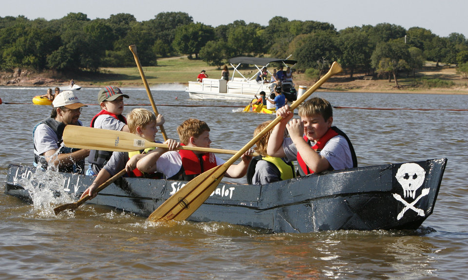 The crew of �Sir Sinksalot� approaches the shore during Edmond�s Cardboard Boat Regatta at Arcadia Lake in Edmond last August. The Edmond City Council passed an ordinance this week limiting most boats allowed on the lake to 26 feet in length. Photo By Paul Hellstern,  The Oklahoman Archive