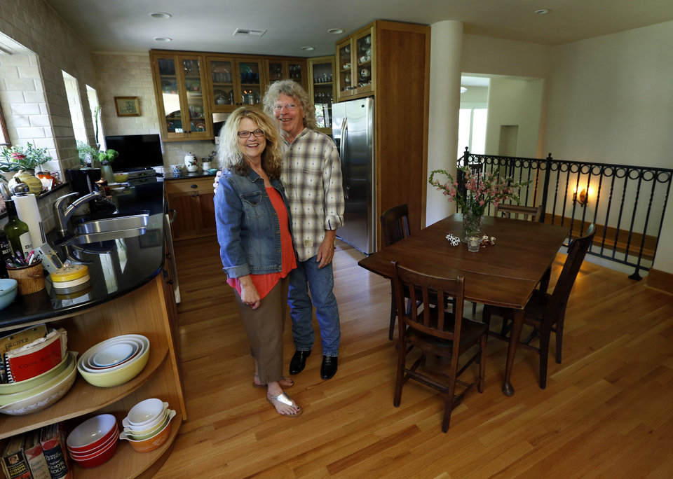 Photo - Michael Brinkley and Lynda Donley stand in the kitchen of their home at 639 S Lahoma in Norman. The State Historic Preservation Office recognized them with a Certificate of Merit for rehabilitating the 1921 residence.  PHOTOs BY STEVE SISNEY, THE OKLAHOMAN  STEVE SISNEY -  THE OKLAHOMAN