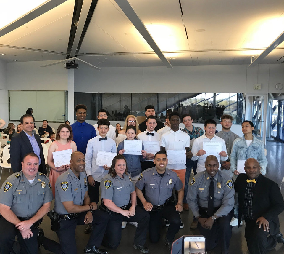 Photo -  Recent graduates of the Oklahoma City Police Department's Juvenile Intervention Program pose with police officers and supporters of the program at a recent program graduation at the Devon Boathouse. [Photo by Carla Hinton, The Oklahoman]