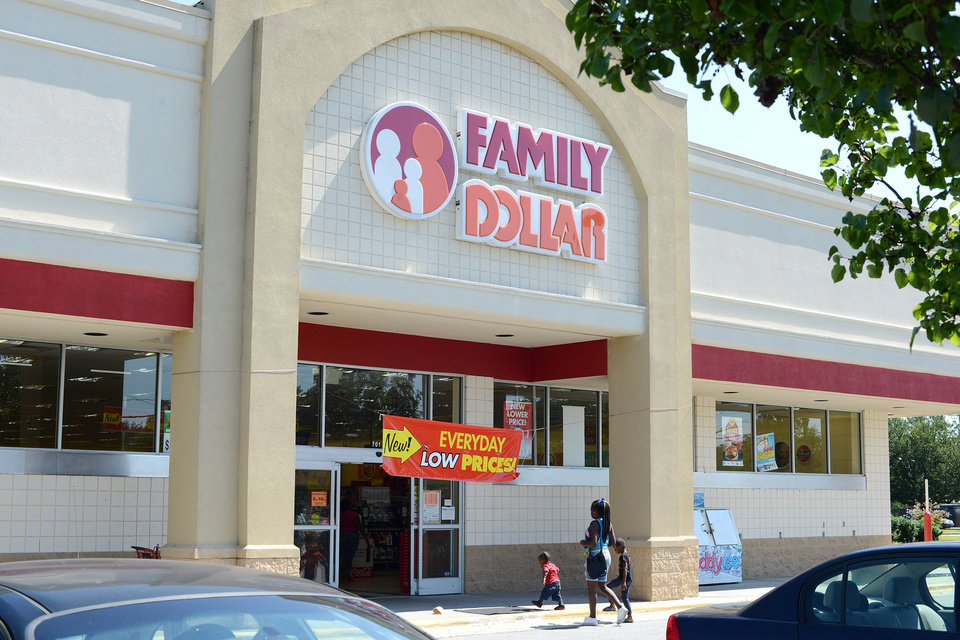 Photo - In this Tuesday, July 29, 2014 photo,  customers enter a Family Dollar store on Plaza Boulevard, in Kinston, N.C. There's now a bidding war for Family Dollar, with Dollar General offering about $9.7 billion for the discounter in an effort to trump Dollar Tree's bid of $8.5 billion. (AP Photo/Kinston Free Press, Janet S. Carter)