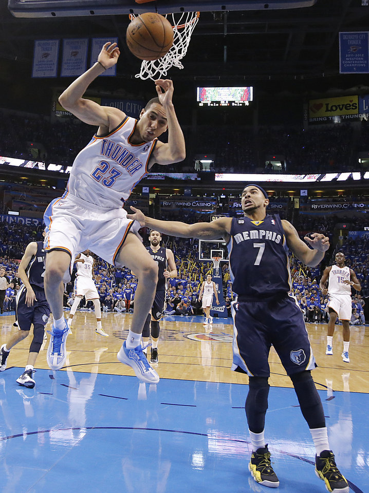 Oklahoma City's Kevin Martin (23) is fouled by Memphis' Jerryd Bayless (7) during the second round NBA playoff basketball game between the Oklahoma City Thunder and the Memphis Grizzlies at Chesapeake Energy Arena in Oklahoma City, Sunday, May 5, 2013. Photo by Chris Landsberger, The Oklahoman