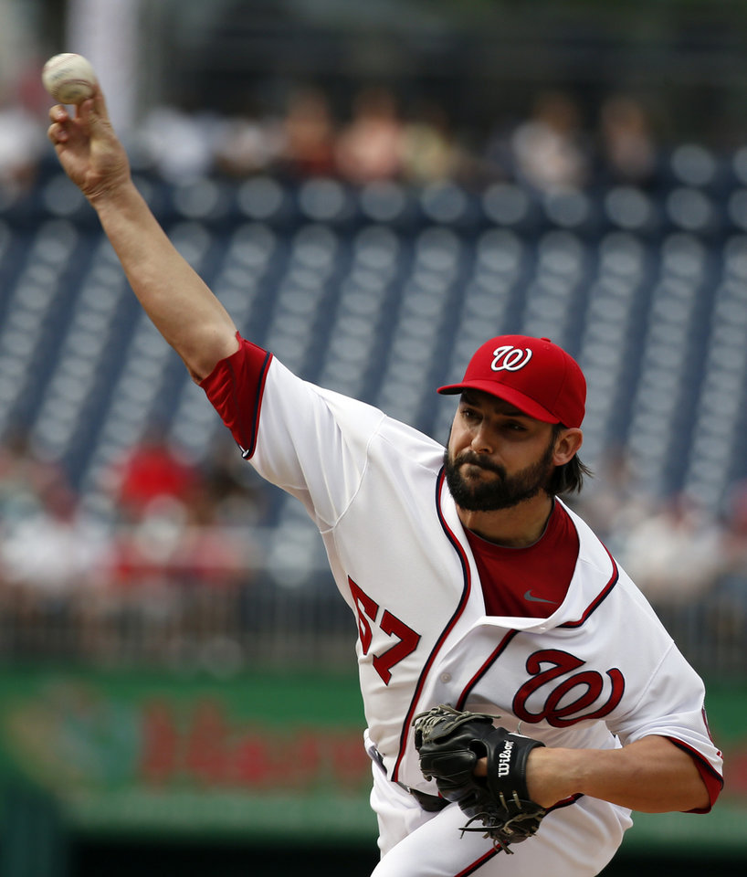 Photo - Washington Nationals starting pitcher Tanner Roark (57) throws during the first inning of a baseball game against the Cincinnati Reds at Nationals Park Wednesday, May 21, 2014, in Washington. (AP Photo/Alex Brandon)