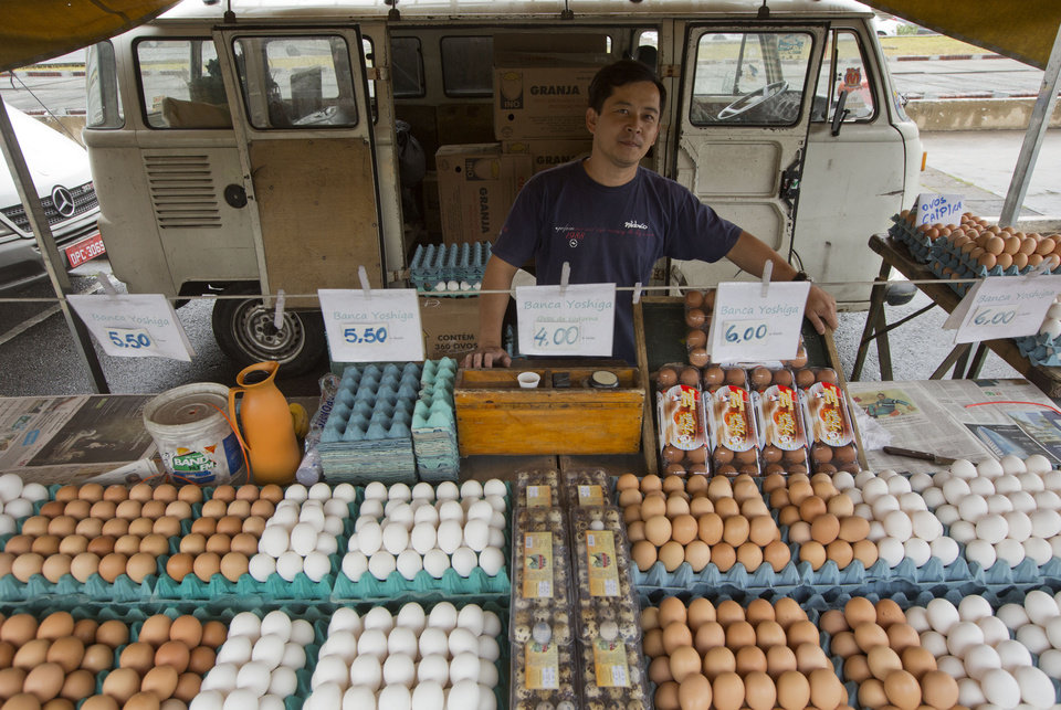 Photo - In this Sept. 17, 2013 photo, street vendor Marcos Yoshiga uses his Volkswagen van to transport his crates of eggs to sell at a street market in Sao Paulo, Brazil. Brazil is the last place in the world still producing the iconic vehicle, or