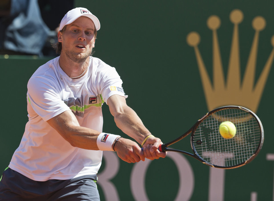 Photo - Andreas Seppi of Italy, returns the ball to Rafael Nadal of Spain during their third round match of the Monte Carlo Tennis Masters tournament in Monaco, Thursday, April 17, 2014. Nadal won 6-1 6-3. (AP Photo/Michel Euler)