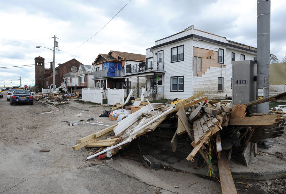 Debris and destroyed homes line streets in Long Beach, N.Y. Thursday, Nov. 1, 2012. Three days after Sandy slammed the mid-Atlantic and the Northeast, New York and New Jersey struggled to get back on their feet, the U.S. death toll climbed to more than 80, and more than 4.6 million homes and businesses were still without power. (AP Photo/Kathy Kmonicek)