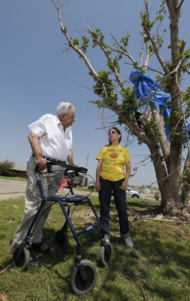 John Roady talks with neighbor Christinia Cloptan on the lawn of his property. Roady stands with his new walker, which he received from an organization replacing tornado survivors' lost medical equipment. Roady and his wife Helen lost their home in Moore on May 20. <strong>STEVE SISNEY - THE OKLAHOMAN</strong>