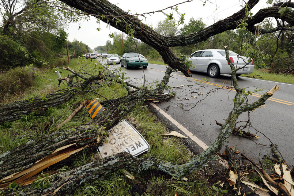 Photo - Traffic was snarled by trees and power lines on 156th street and Franklin Road after a tornado ripped through the area on Sunday, May 19, 2013  in Norman, Okla. Photo by Steve Sisney, The Oklahoman