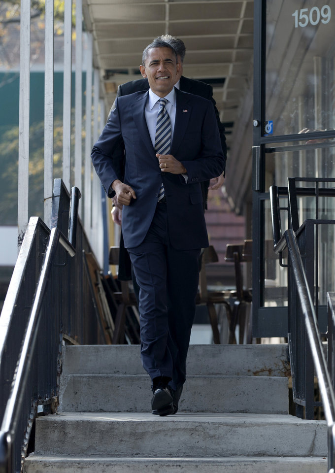 President Barack Obama leaves a campaign office on the morning of the 2012 election, Tuesday, Nov. 6, 2012, in Chicago, after visiting with volunteers. (AP Photo/Carolyn Kaster)