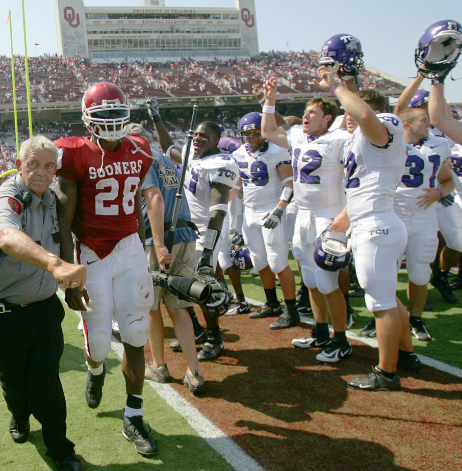 Photo - COLLEGE FOOTBALL, TEXAS CHRISTIAN UNIVERSITY: University of Oklahoma Sooners running back Adrian Peterson (28) walks past the TCU team as they celebrate their 17-10 victory over OU in the 2005 season opener at  The Gaylord Family-Oklahoma Memorial Stadium, in Norman, Oklahoma Saturday, September 3, 2005.   By Bryan Terry/The Oklahoman