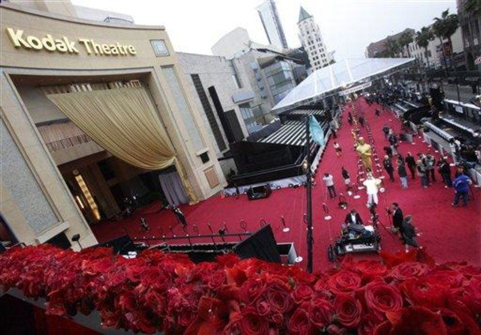 People bustle about the red carpet outside the Kodak Theatre as preparations continue for the 84th Academy Awards in Los Angeles on Sunday, Feb. 26, 2012. The Oscars will be held later in the day.