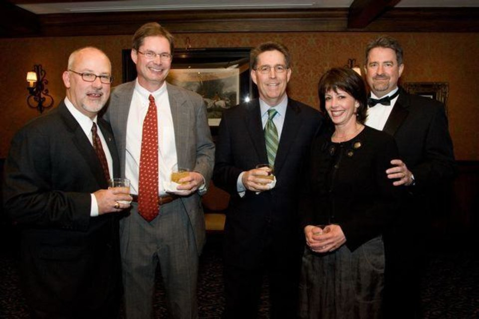 SAE'S CELEBRATE 100...Randy Anderson, Dr. Tom Merrill, Clint Smith, Annalisa Taylor and Robert Bell celebrate Sigma Alpha Epsilon's anniversary. (Photo by Steve Maupin).