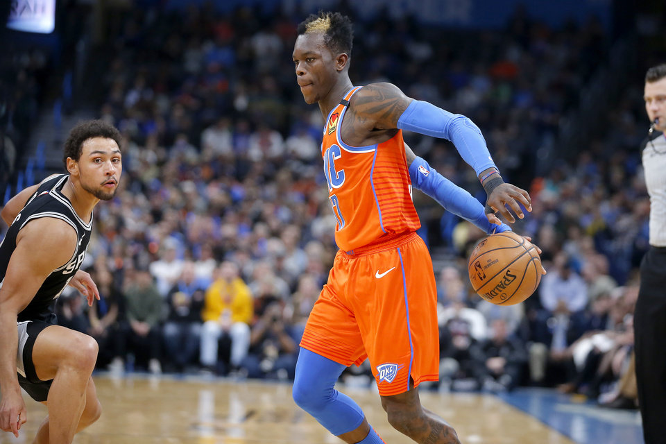Photo - Oklahoma City's Dennis Schroder (17) goes past San Antonio's Bryn Forbes (11) during an NBA basketball game between the Oklahoma City Thunder and the San Antonio Spurs at Chesapeake Energy Arena in Oklahoma City, Sunday, Feb. 23, 2020. Oklahoma city won 131-103. [Bryan Terry/The Oklahoman]