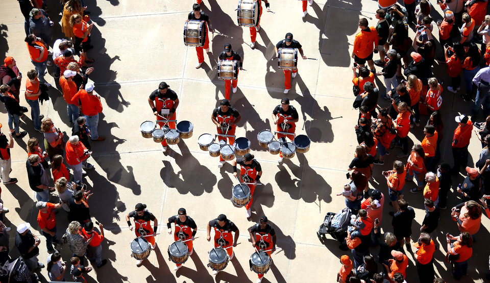 Photo - Fans cheer as OSU band walks in the stadium during the Spirit Walk before the college football game between Oklahoma State University and Baylor at Boone Pickens Stadium in Stillwater, Okla., Saturday, Oct. 19, 2019. [Sarah Phipps/The Oklahoman]