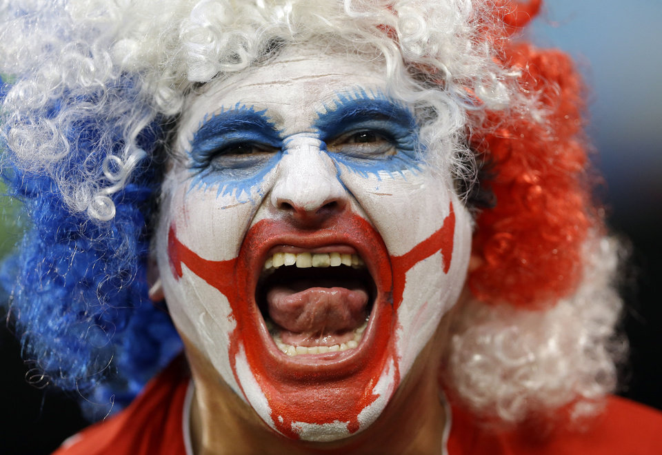 Photo - A spectator from Chile yells before the group B World Cup soccer match between Chile and Australia in the Arena Pantanal in Cuiaba, Brazil, Friday, June 13, 2014.  (AP Photo/Kirsty Wigglesworth)