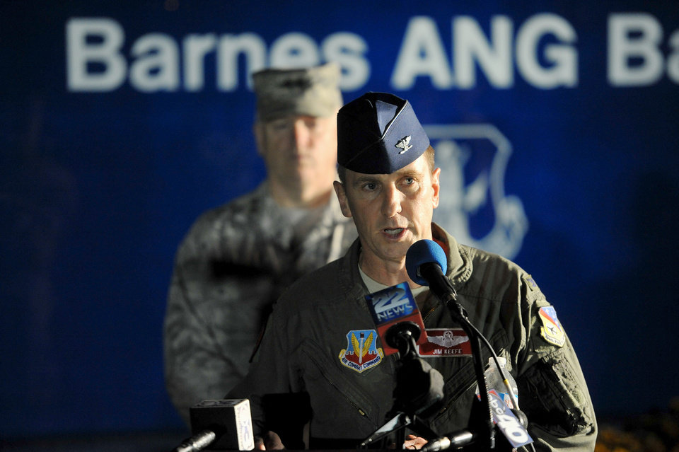 Photo - Col. James Keefe, commander of the 104th Fighter Wing of the Massachusetts Air National guard announces Thursday evening Aug. 28, 2014 the missing F-15C pilot remains have been found in the plane wreckage. Col. Keefe announced the news at the Massachusetts Air National Guard in Westfield, Massachusetts, home of the 104th Fighter Wing, where the pilot and jet were based. (AP Photo/The Republican, Dave Roback)