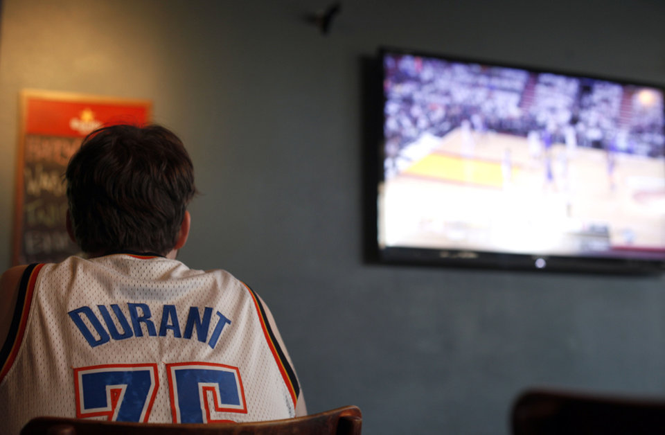 Photo - Wes Behrens watches the Thunder play Miami in the NBA Finals on television at Saint's Pub in Oklahoma City, Sunday, June 17, 2012. Photo by Sarah Phipps, The Oklahoman  SARAH PHIPPS - SARAH PHIPPS