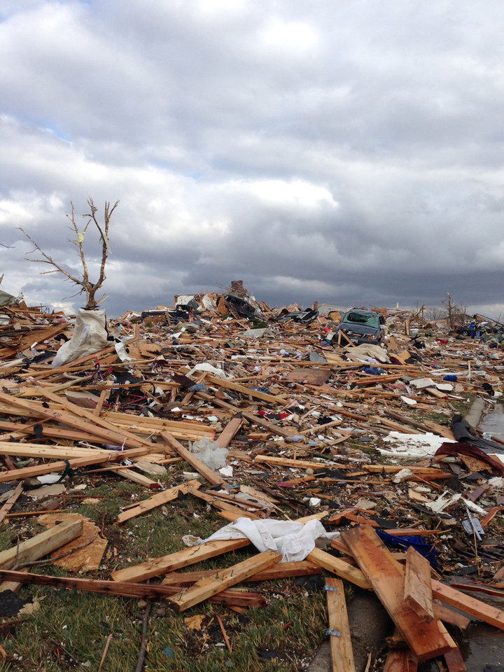 Photo - A view of part of Washington, Ill. is seen from Mackenzie Street in Washington, Sunday, Nov. 17, 2013 after a tornado moved through the area. Intense thunderstorms and tornadoes swept across the Midwest on Sunday, causing extensive damage in several central Illinois communities while sending people to their basements for shelter and even prompting officials at Soldier Field in Chicago to evacuate the stands and delay the Bears game.  (AP Photo/Alex Kareotes)