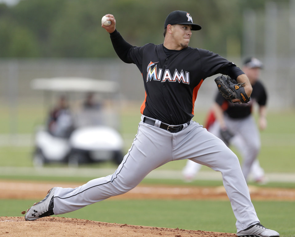 Photo - Miami Marlins non-roster invitee pitcher Jose Fernandez throws a pitch during an exhibition spring training baseball game against the St. Louis Cardinals, Thursday, Feb. 28, 2013, in Jupiter, Fla. (AP Photo/Julio Cortez)