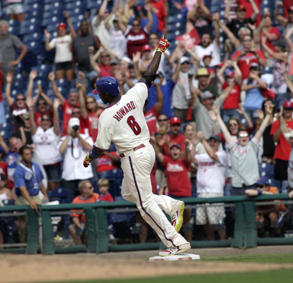 Photo - Philadelphia Phillies' Ryan Howard  celebrates after he hit a one run single against the New York Mets in the ninth inning of a baseball game Sunday, Aug. 10, 2014, in Philadelphia. The Phillies won 7-6.  (AP Photo/H. Rumph Jr)