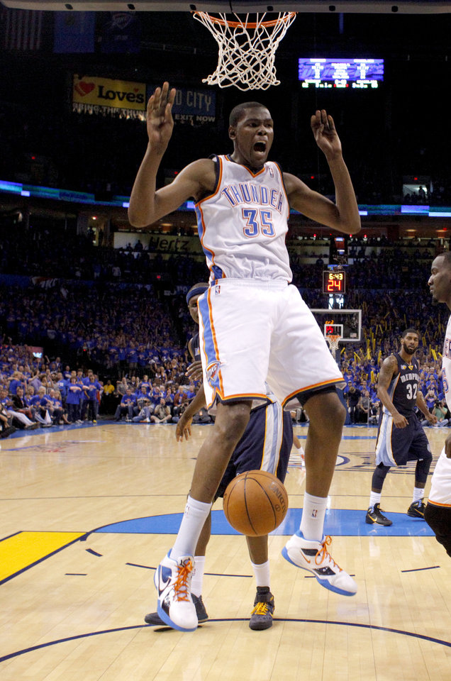 Oklahoma City's Kevin Durant (35) reacts after dunking over Zach Randolph (50) of Memphis during game 7 of the NBA basketball Western Conference semifinals between the Memphis Grizzlies and the Oklahoma City Thunder at the OKC Arena in Oklahoma City, Sunday, May 15, 2011. Photo by Sarah Phipps, The Oklahoman