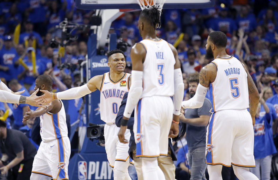 Photo - Oklahoma City celebrates a time out during Game 4 in the first round of the NBA playoffs between the Portland Trail Blazers and the Oklahoma City Thunder at Chesapeake Energy Arena in Oklahoma City, Sunday, April 21, 2019.  Photo by Sarah Phipps, The Oklahoman