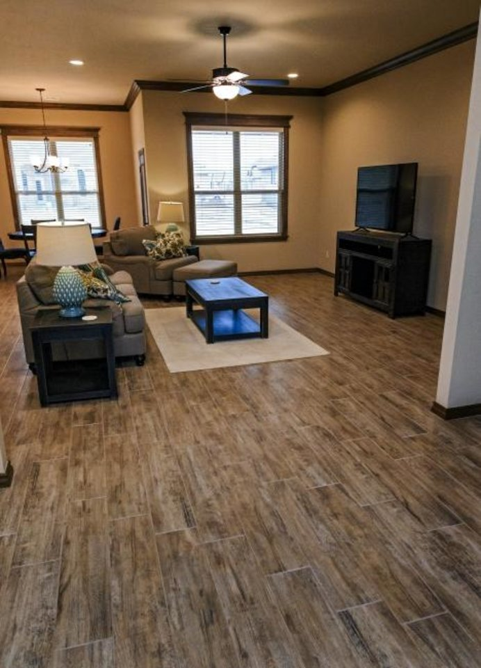 Photo -  Hard flooring in a Vesta Homes model at 12801 Williamson Farm Blvd. [CHRIS LANDSBERGER/THE OKLAHOMAN]