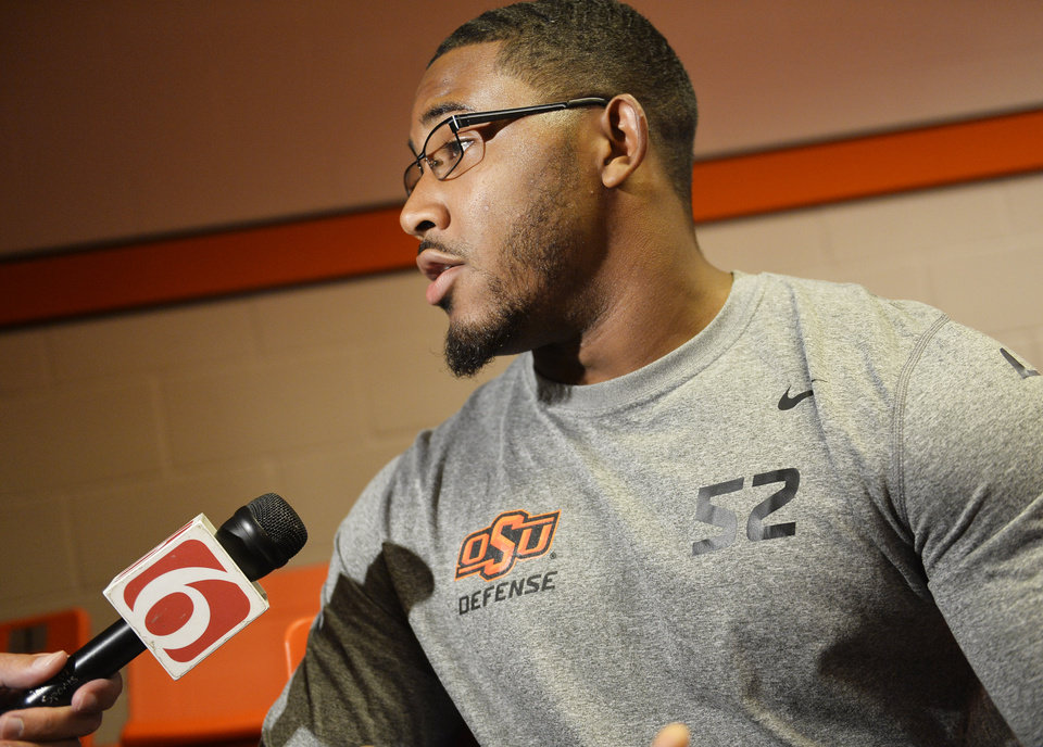 Photo - Oklahoma State linebacker Ryan Simmons speaks with media members at a media availability session inside Gallagher-Iba Arena on Thursday, August 21, 2014. Photo by KT King/For the Oklahoman