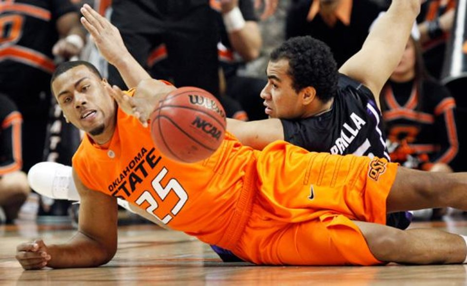 OSU's Darrell Williams (25) and Freddy Asprilla (15) of KSU chase the ball during the men's college basketball game between Oklahoma State University (OSU) and Kansas State University (KSU) at Gallagher-Iba Arena in Stillwater, Okla., Saturday, January 8, 2011. Photo by Nate Billings, The Oklahoman