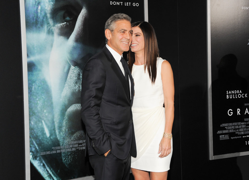 "Photo - Actors George Clooney and Sandra Bullock attend the premiere of ""Gravity"" at the AMC Lincoln Square Theaters on Tuesday, Oct. 1, 2013, in New York. (Photo by Evan Agostini/Invision/AP) ORG XMIT: NYEA112"