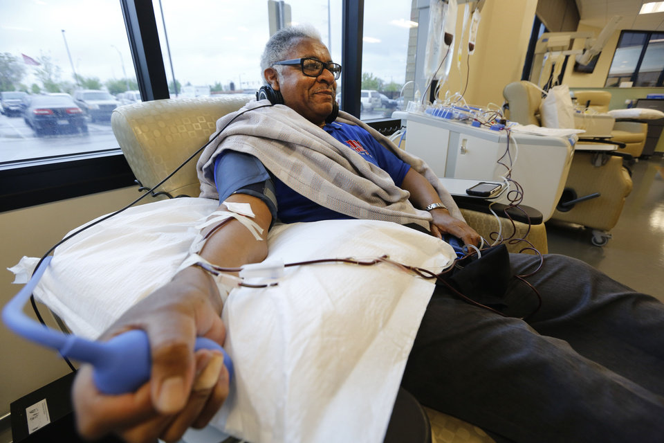 Joseph Eddens donates platelets at the Oklahoma Blood Institute in Oklahoma City. Eddens said he donates platelets on a regular basis because he wants to help people who need them. <strong>Steve Gooch - The Oklahoman</strong>
