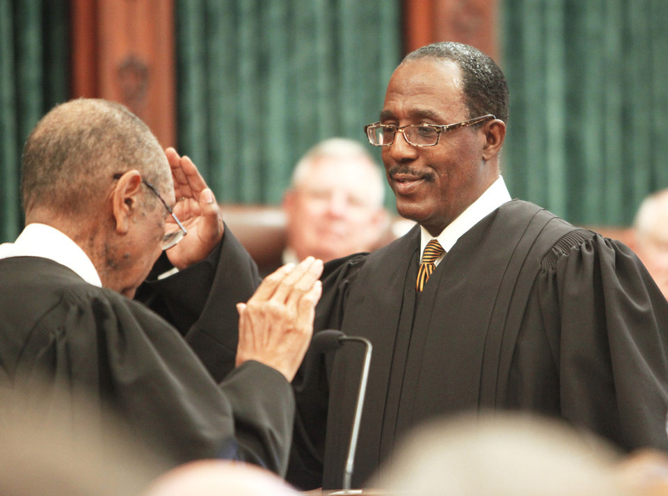 Retired Oklahoma County Judge Charles Owens administers the oath of office Friday to Tom Colbert, the first black chief justice of the Oklahoma Supreme Court. Photo by David McDaniel, The Oklahoman