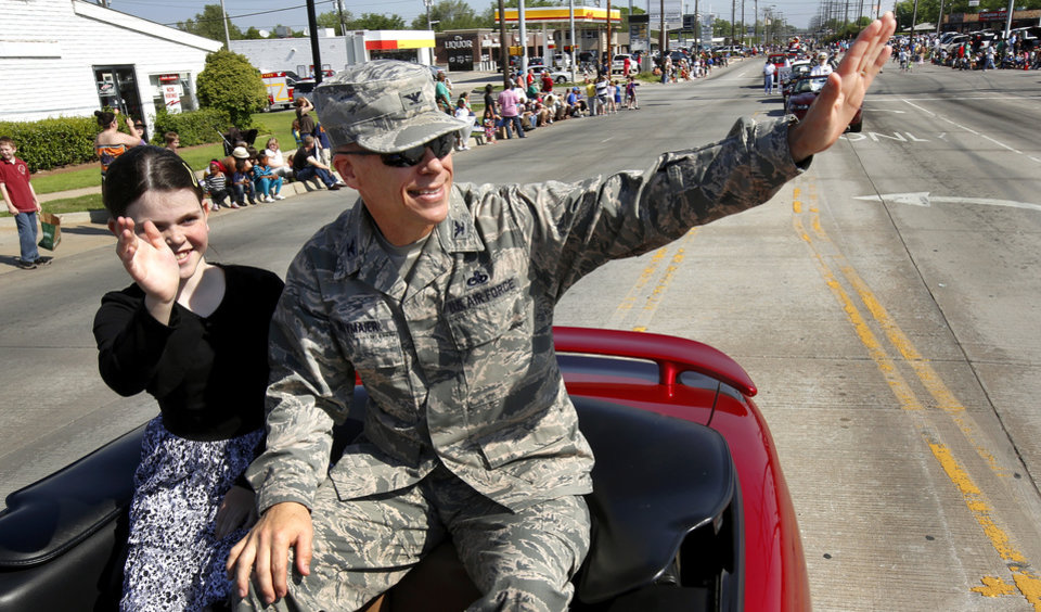 Col. Steven J. Bleymaier, commander, 72nd Air Base Wing, Tinker Air Force Base, waves from a convertible. He is parade marshal for Armed Forces Day parade in Del City, Saturday morning,  May 11, 2013. Photo  by Jim Beckel, The Oklahoman.