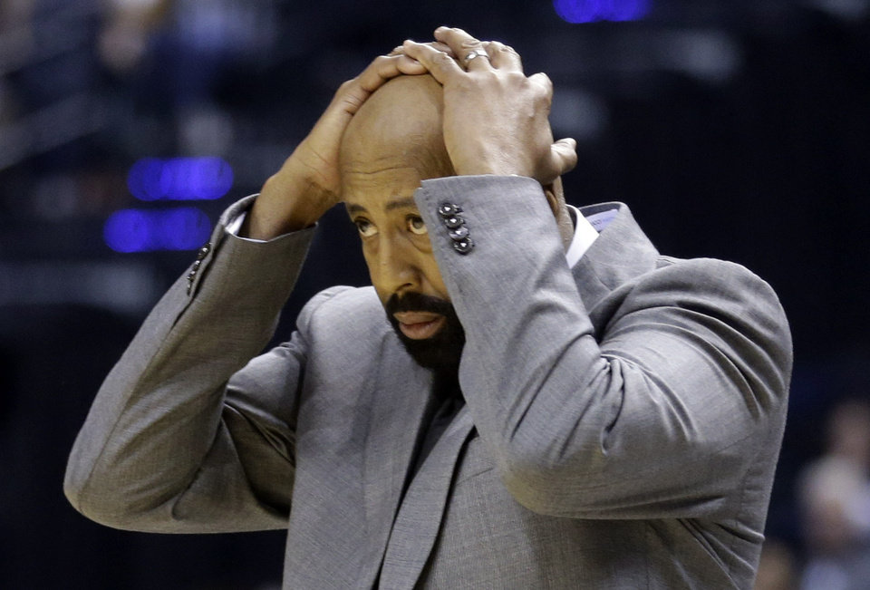 Photo - New York Knicks coach Mike Woodson reacts to a call in the first half of an NBA basketball game against the Indiana Pacers in Indianapolis, Thursday, Jan. 16, 2014. (AP Photo/Michael Conroy)