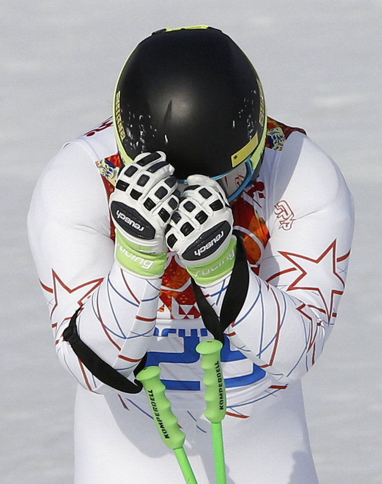 Photo - United States' Andrew Weibrecht reacts at the end of his run in the men's super-G at the Sochi 2014 Winter Olympics, Sunday, Feb. 16, 2014, in Krasnaya Polyana, Russia.(AP Photo/Christophe Ena)