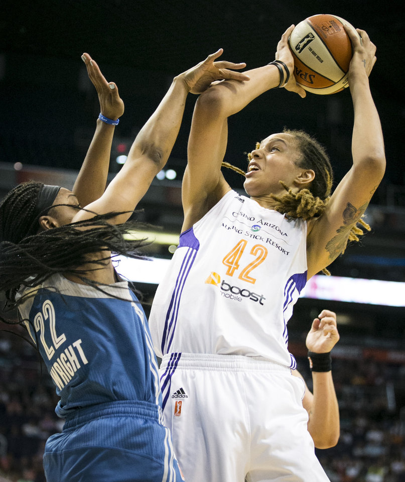 Photo - Phoenix Mercury center Brittney Griner is fouled by Minnesota Lynx guard Monica Wright during a WNBA basketball game Saturday, Aug. 9, 2014, in Phoenix. (AP Photo/The Arizona Republic, Pat Shanahan)