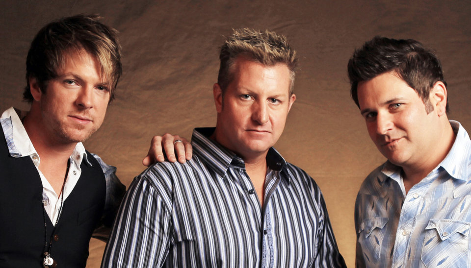 Photo - This Sept. 29, 2010 file photo shows Picher-bred Joe Don Rooney, left, Gary Levox, and Jay DeMarcus, right, of Rascal Flatts in Nashville, Tenn.  (AP Photo/Mark Humphrey, File)  Mark Humphrey - AP