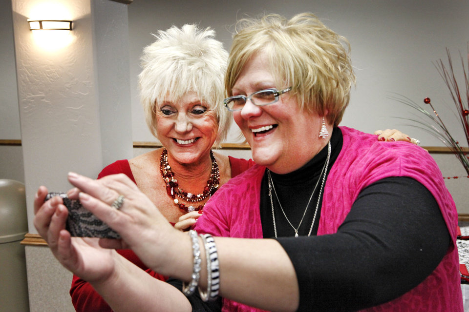 Photo - Edmond City Clerk Nancy Nichols poses for a photo with friend Terry Frazier at her retirement party. Nichols has been with the city for 28 years. PHOTO BY DAVID MCDANIEL, THE OKLAHOMAN  David McDaniel - The Oklahoman