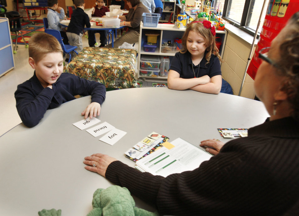 Photo - Special Education teacher Linda Felton works with eight year old Gabriel Brown and 7 year old Zada Lamb during a class for autistic children at Sequoyah Elementary School in Oklahoma City, OK, Thursday, Feb. 9, 2012. By Paul Hellstern, The Oklahoman