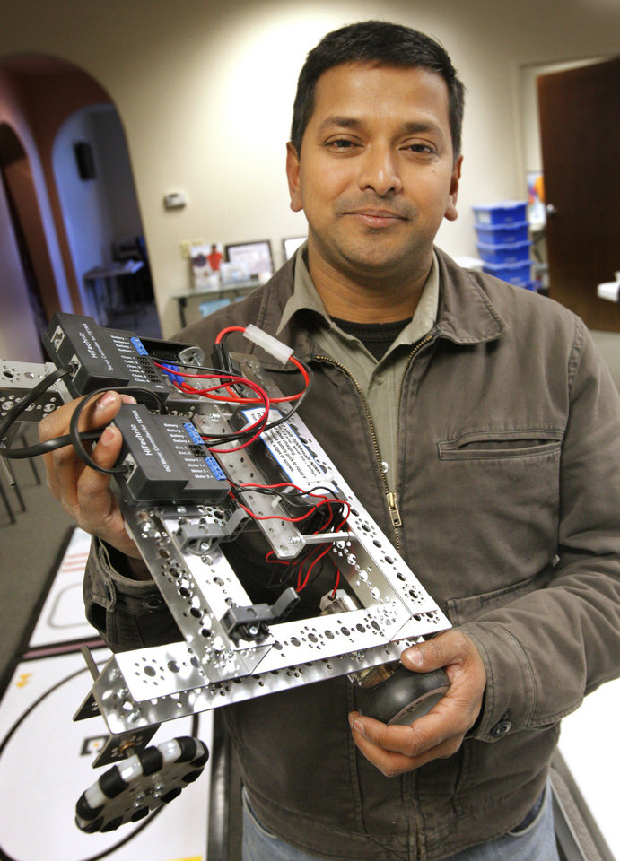 Photo - Ramier Shaik , founder and CEO of techJOYnT, with a robot used by students at techJOYnT in Oklahoma City Monday, Jan. 9, 2011. Photo by Paul B. Southerland, The Oklahoman ORG XMIT: KOD