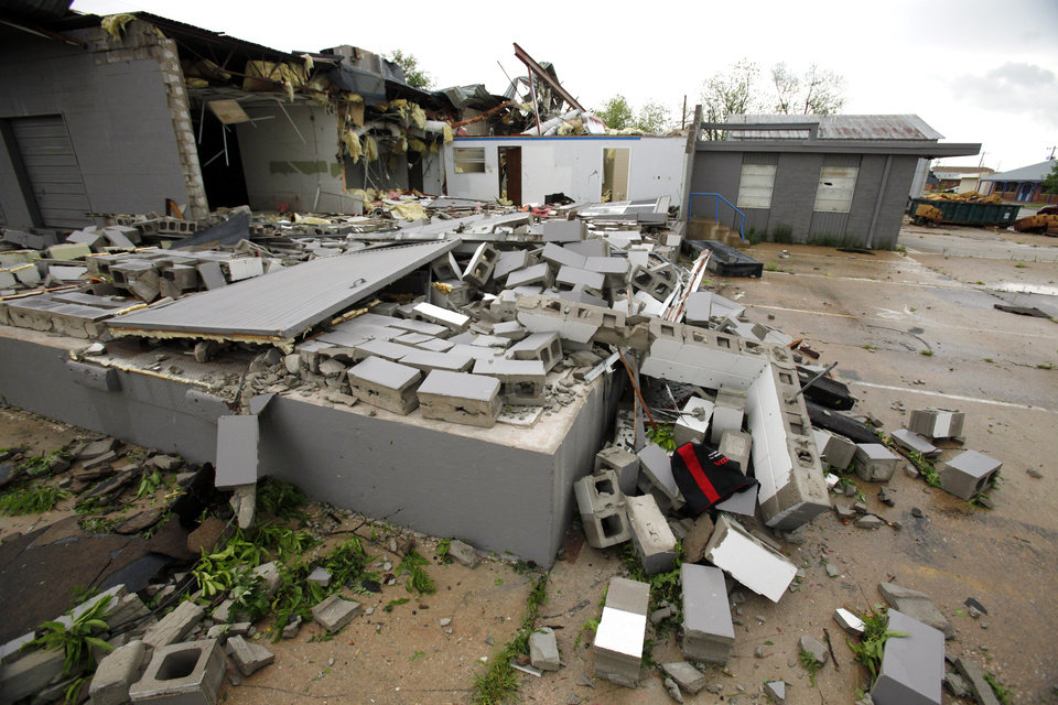 A business at Jones and Tonhawa in central Norman was flattened from a reported tornado that struck the west and central pars of town on Friday, April 13, 2012, in Norman, Okla.  Photo by Steve Sisney, The Oklahoman