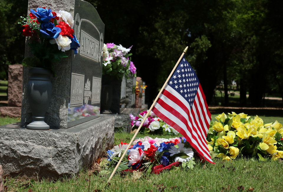 Photo -  American flags are posted at Memorial Park Cemetery in Oklahoma City.
