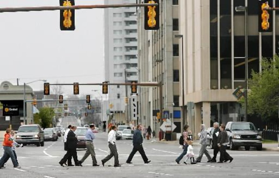 Downtown  pedestrians hurry to cross N Hudson between the County Courthouse and  City Hall in downtown  Oklahoma  City Thursday, March 19, 2009. BY JIM BECKEL