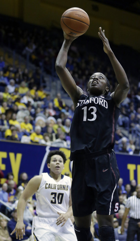 Photo - Stanford forward Chiney Ogwumike (13) scores past California guard Mikayla Lyles (30) during the first half on an NCAA college basketball game on Sunday, Feb. 2, 2014, in Berkeley, Calif. (AP Photo/Marcio Jose Sanchez)