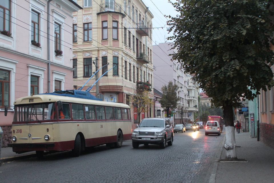 In this photo taken on Oct. 21 2012, an old trolley bus is parked on a central street in Chernivtsi, a city of 250,000 in southwestern Ukraine. Known as the Little Paris or, alternatively, the Little Vienna of Ukraine, Chernivtsi is a perfect place for a quiet romantic weekend trip and a crash course in the painful history of Europe in the 20th century. (AP Photo/Maria Danilova)