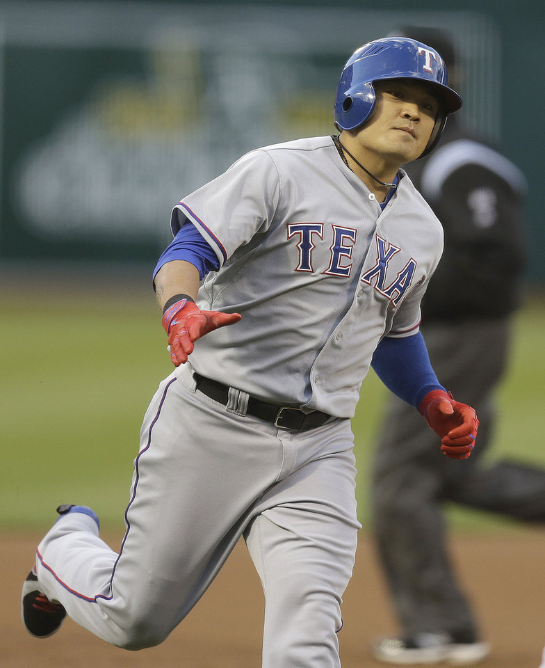 Photo - Texas Rangers' Shin-Soo Choo of Korea runs the bases after hitting a home run off Oakland Athletics' Dan Straily in the first inning of a baseball game Monday, April 21, 2014, in Oakland, Calif. (AP Photo/Ben Margot)