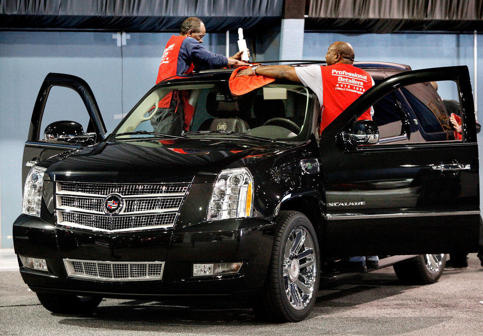 Men with Professional Detailers of Oklahoma City get a Cadillac Escalade Hybrid all shined up for the show. Workers stayed busy most of Tuesday, Mar. 1, 2011. setting up displays and placing cars in the right spots in preparation for this week\'s Auto Show at State Fair Park. Photo by Jim Beckel, The Oklahoman