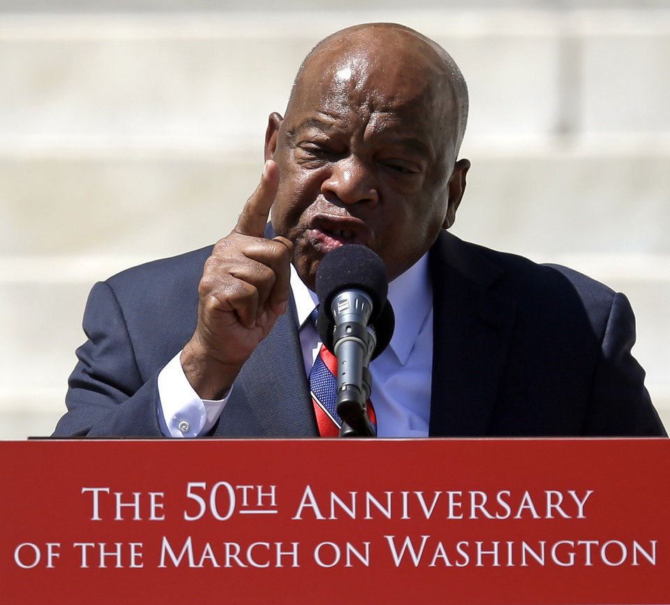 "Civil rights leader Rep. John Lewis, D-Ga., speaks at a rally to commemorate the 50th anniversary of the 1963 March on Washington on the steps of the Lincoln Memorial on Saturday, Aug. 24, 2013, in Washington. Lewis marched in the from line with the Rev. Martin Luther King Jr. on Aug. 24, 2013, the day King gave his famous ""I Have a Dream"" speech. (AP Photo/Carolyn Kaster)"
