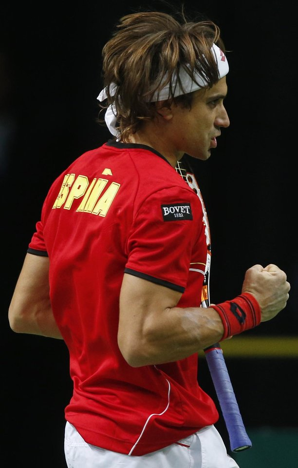 Spain's David Ferrer reacts during the tennis Davis Cup finals singles match against Czech Republic's Tomas Berdych in Prague, Czech Republic, Sunday, Nov. 18, 2012. (AP Photo/Petr David Josek)