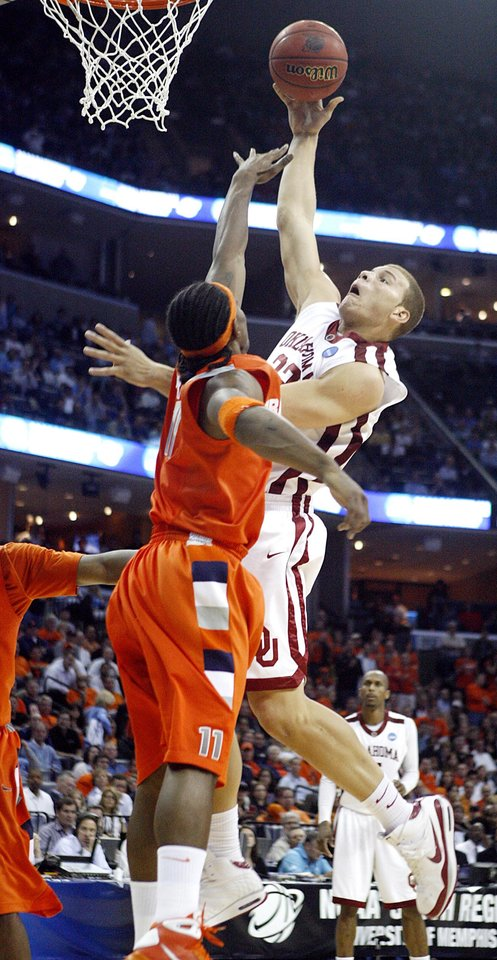 Oklahoma's Blake Griffin (23) puts up a shot over Syracuse's Paul Harris (11) during the second half of the NCAA Men's Basketball Regional at the FedEx Forum on Friday, March 27, 2009, in Memphis, Tenn.