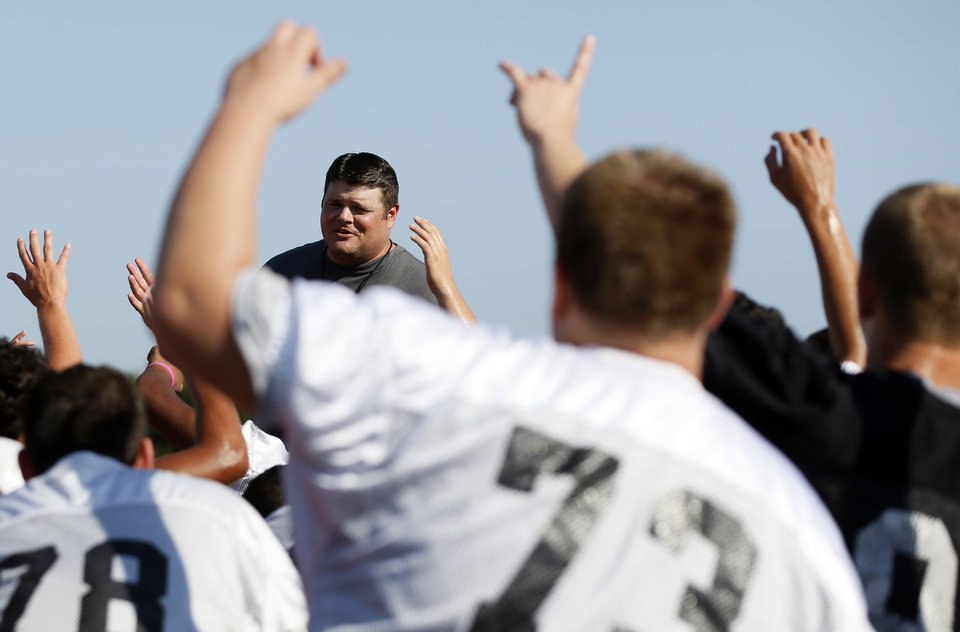 Coach Jeremy Dombek talks to his players during football practice at Mustang High School in Mustang, Okla., Wednesday, Aug. 13, 2014. Photo by Nate Billings, The Oklahoman